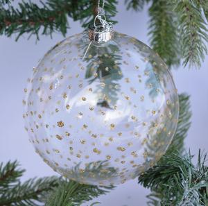 Julgranskula i glas med guldprickar